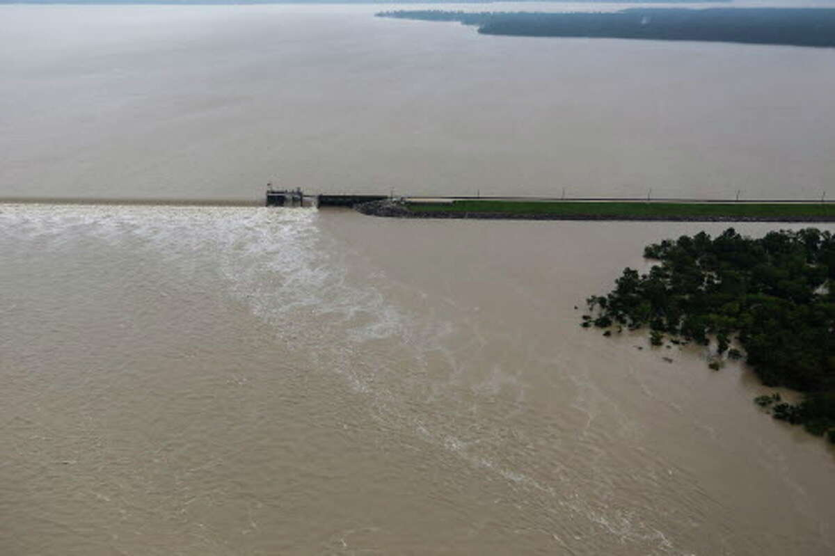 The spillway of Lake Houston overflows from Tropical Storm Harvey on Tuesday, Aug. 29, 2017, in Houston.