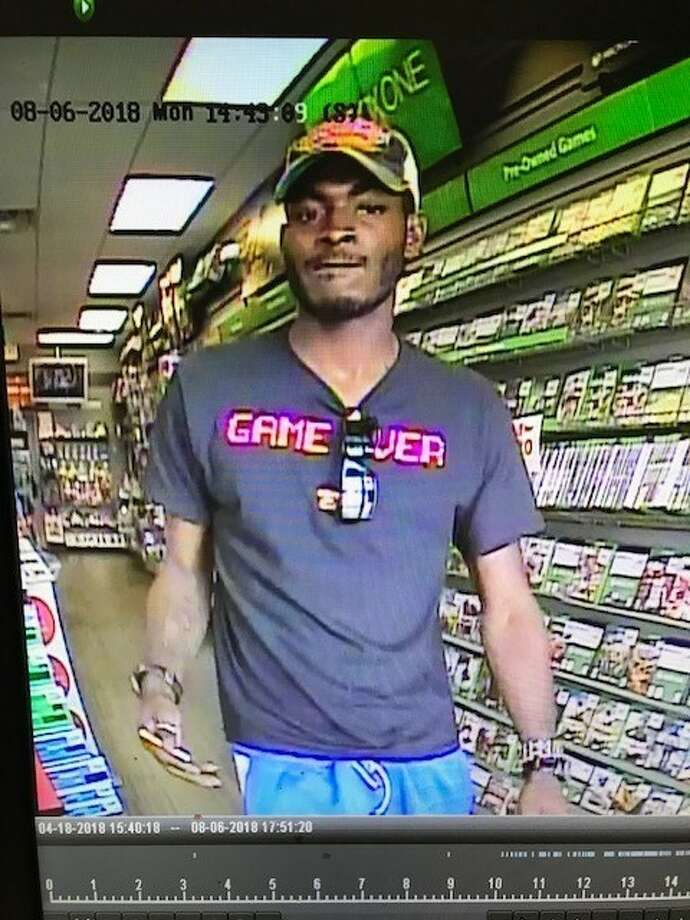 The suspect pictured was caught on surveillance camera, allegedly attempting to make a video game console purchase with a credit card stolen during an Aug. 6, 2018 vehicle burglary in Friendswood. Photo: Friendswood Police Department