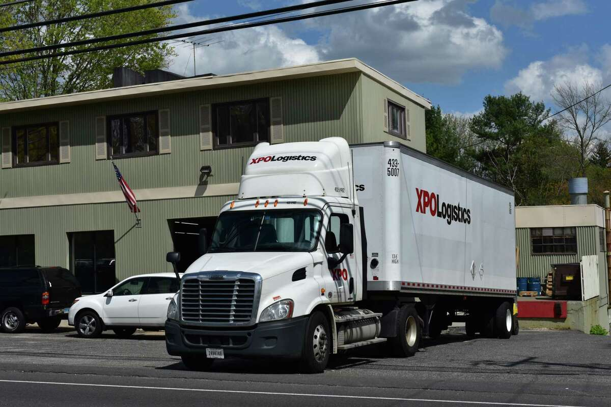 An XPO Logistics driver makes a delivery in May 2017 in Monroe, Conn.
