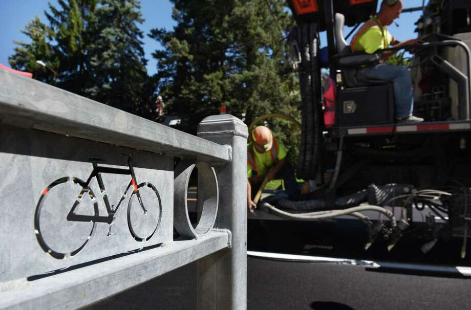 Lines are painted on Madison Ave., to create new bikes lanes and define traffic boundaries following a repave on Monday, Aug. 22, 2016, in Albany, N.Y. (Will Waldron/Times Union) Photo: Will Waldron, Albany Times Union / 20037738A