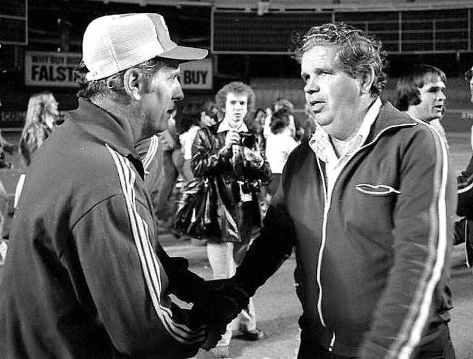 Late SIUE soccer coach Bob Guelker, left, and late Saint Louis Univreisty coach Harry Keough shake hands following the 1977 Bronze Boot Game at Busch Stadium II. Photo:       File Photo