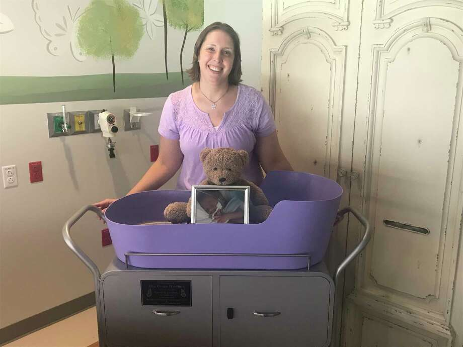 A caring cradle, donated to Texas Children's Hospital in the Woodlands by Katie and Phillip Hurlbut, dons a commemorative plaque in honor of Ella Hurlbut who passed away in 2015. Photo: Courtesy Of Katie Hurlbut