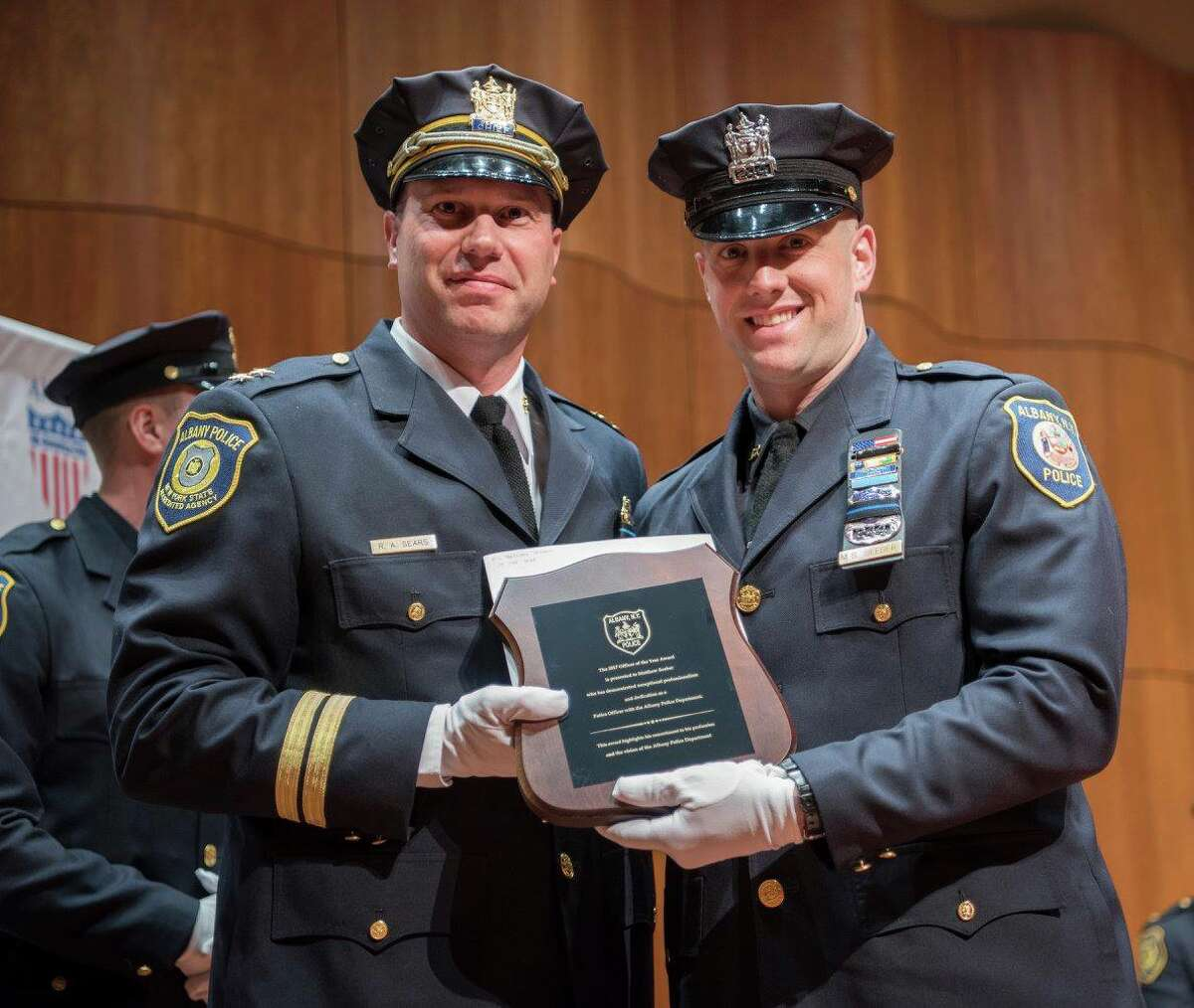 Matthew Seeber, right, receives the Officer of the Year Award from the Albany Police Department on May 15, 2018.