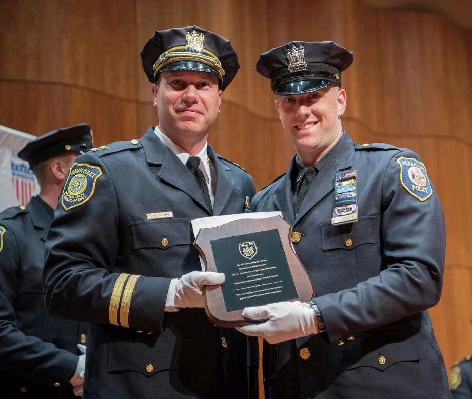 Matthew Seeber, right, receives the Officer of the Year Award from the Albany Police Department on May 15, 2018. Photo: Albany Police Department Facebook