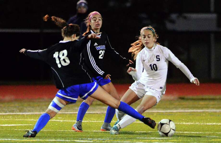 Eilanna Dolan (18) defends during the state semifinal game last season. Photo: Christian Abraham / Hearst Connecticut Media / Connecticut Post
