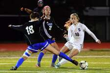 Eilanna Dolan (18) defends during the state semifinal game last season.