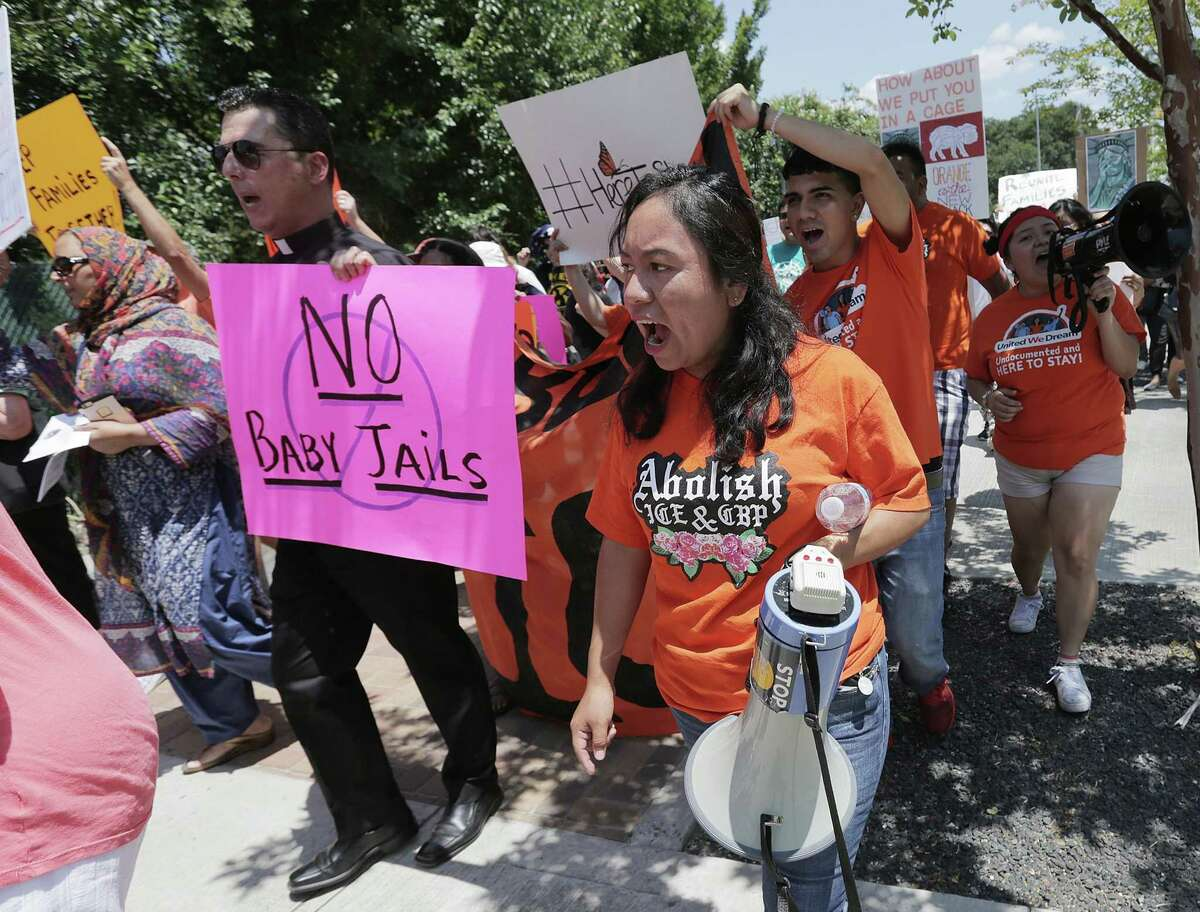 Marchers chant as they make their way to the site of the proposed detention center at 419 Emancipation Avenue to call for the reunification of immigrant families separated by the Trump Administration on Saturday, July 28, 2018 in Houston.