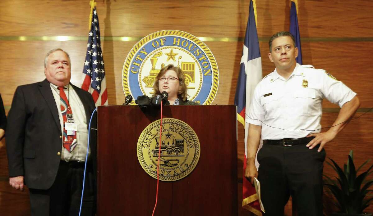 Patrick Ley, assistant director of the Health Department (left-right), Carol Haddock, director of Houston Public Works and Houston Fire Department Chief Samuel Pena tell reporters that permits have not been issued for the Southwest Key facility, 419 Emancipation, to house migrant children. Wednesday, Aug. 1, 2018, in Houston. ( Steve Gonzales / Houston Chronicle )
