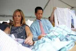 Shoppers peruse clothing from Vineyard Vines in July 2017 in Greenwich, Conn. The state is bringing back its annual sales tax holiday for Aug. 20-25, 2018, with buyers able to avoid paying sales tax on many items of clothing and footwear with some exemptions.