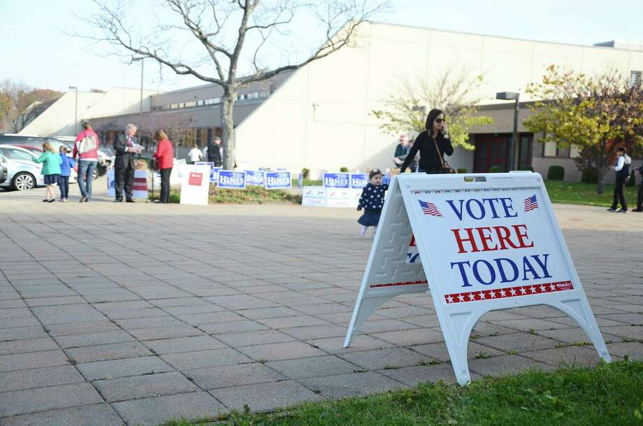 Voters head to the polls at New Canaan High School, one of the town's two polling stations along with Saxe Middle School. As of 9 a.m., more than 1,300 residents had cast their votes. Photo: Nelson Oliveira / Nelson Oliveira / New Canaan News