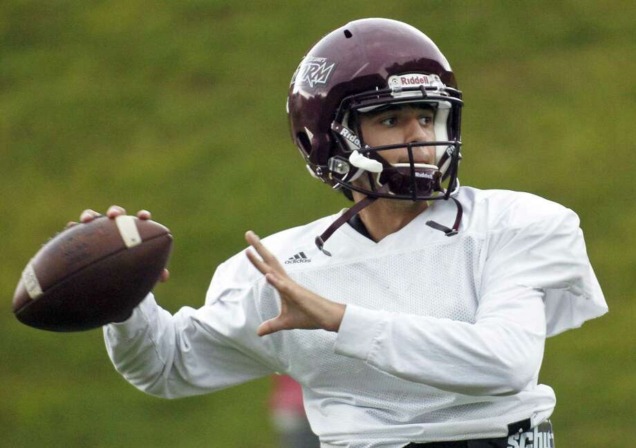 St. Luke's quarterback Michael Hage warms up during a team practice last season. Photo: Matthew Brown / Hearst Connecticut Media / Stamford Advocate