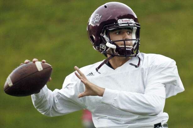 St. Luke's quarterback Michael Hage warms up during a team practice last season.