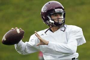 St. Luke's quarterback Michael Hage warms up during a team practice last season.