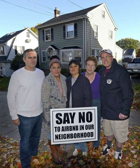 From left, Stephen Rich, Emily Ray, Gaby Pareja, Kathleen Connole and Anthony Rinaldi are photograph on Nov. 4, 2016, as they stand before the house at 20 Grandview Ave., in Stamford's Hubbard Heights neighborhood, that was purchased in August 2016 and turned into an Airbnb host house. Photo: Matthew Brown / Hearst Connecticut Media / Stamford Advocate
