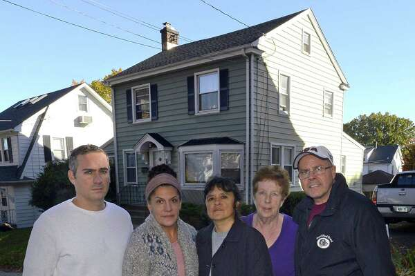 From left, Stephen Rich, Emily Ray, Gaby Pareja, Kathleen Connole and Anthony Rinaldi are photograph on Nov. 4, 2016, as they stand before the house at 20 Grandview Ave., in Stamford's Hubbard Heights neighborhood, that was purchased in August 2016 and turned into an Airbnb host house.