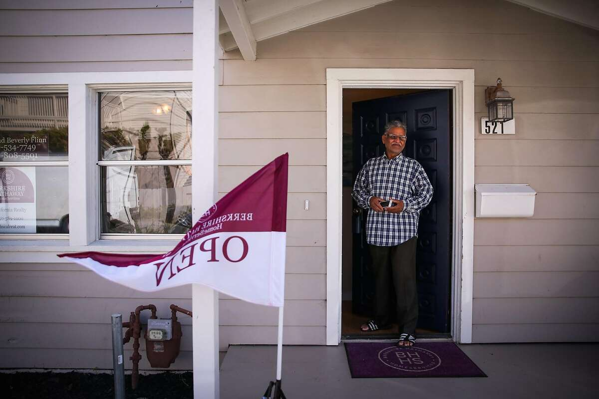 Ashok Patel stands in the doorway of a house that is for sale on 2nd Lane during an open house in South San Francisco, California, on Sunday, April 22, 2018.