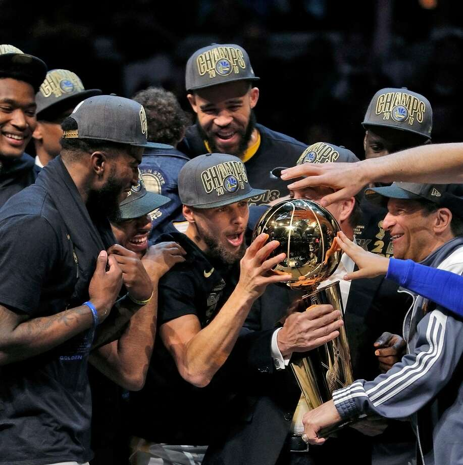 Stephen Curry (30) touches the Larry O'Brien Trophy after the Golden State Warriors defeated the Cleveland Cavaliers in Game 4 of the NBA Finals at Quicken Loans Arena in Cleveland, Ohio, on Friday, June 8, 2018. The Warriors won 108-85 to win the the 2018 NBA Championship. Photo: Carlos Avila Gonzalez / The Chronicle