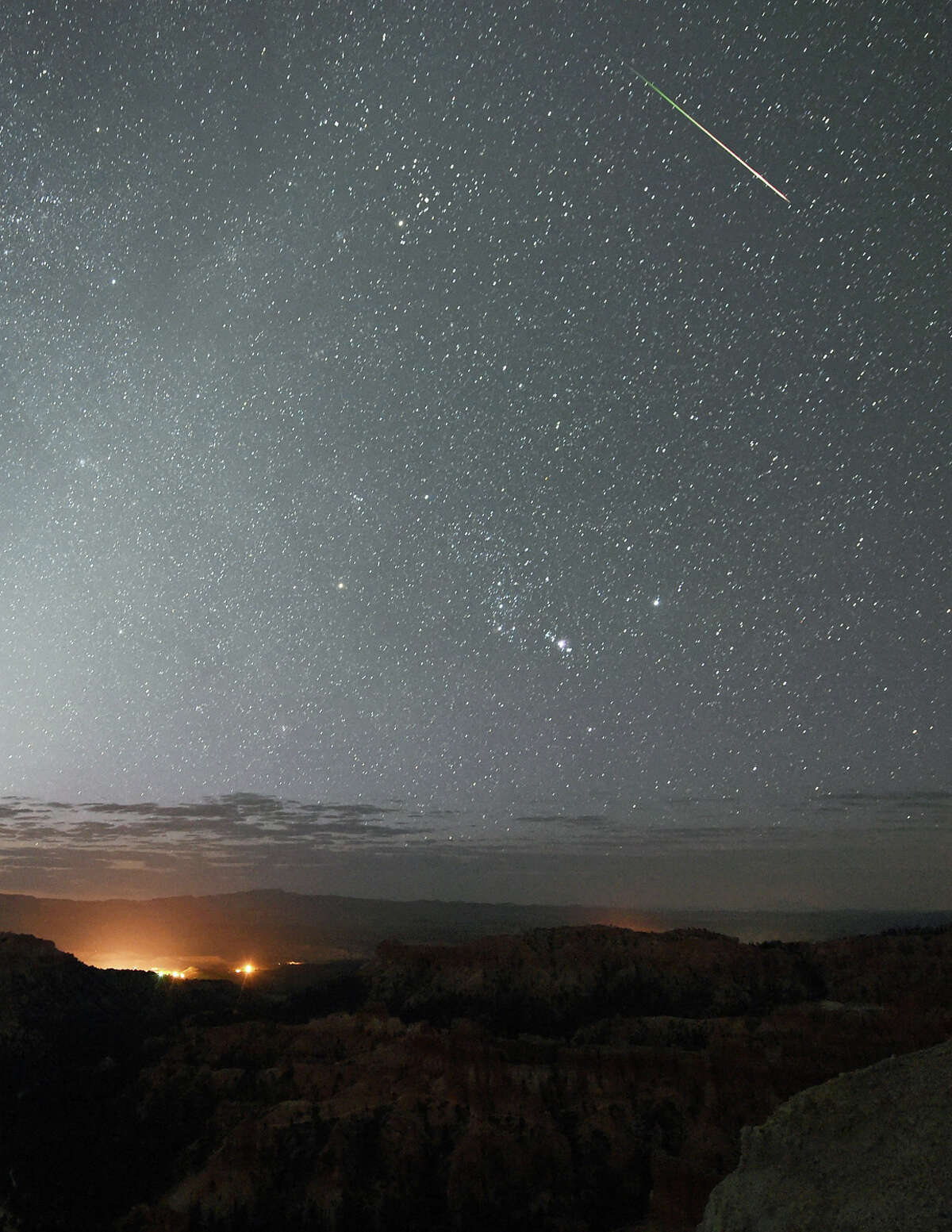 FILE-- A Perseid meteor streaks across the sky above Inspiration Point early on August 12, 2016 in Bryce Canyon National Park, Utah. A new paper by a trio of Harvard University researchers argues that we all might be immigrants from deep space, brought to Earth via a mechanism called panspermia.