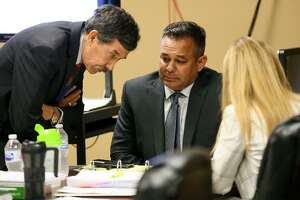 David James Gomez (center) confers with defense attorney's George Shaffer (left) and Jacqueline Kriebel during a morning recess at the start of his murder trial in Felony Impact Court, presided by Dick Alcala, in the Bexar County Courthouse on Wednesday, Aug. 8, 2018.  Gomez is accused of killing his business partner, Isaias Flores, after the two argued at the car shop they owned in the 900 block of Bitters Road on April 7, 2015.  Gomez has claimed self-defense.