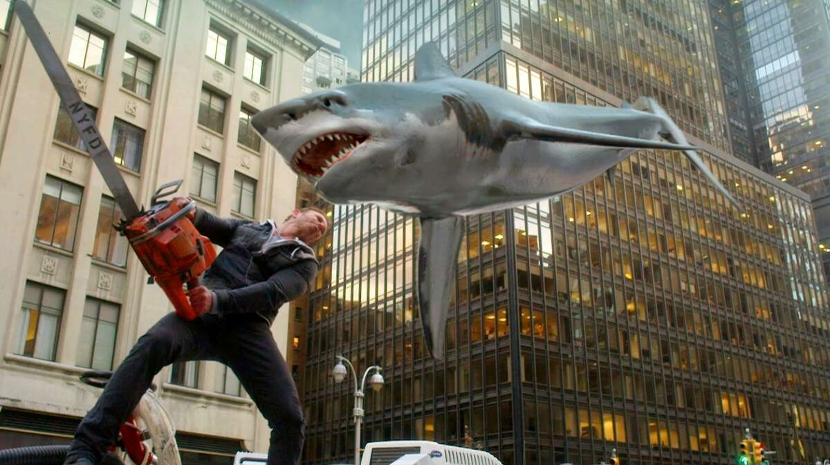 "Ian Ziering, as Fin Shepard, battles a shark on a New York City street in ""Sharknado 2: The Second One."""