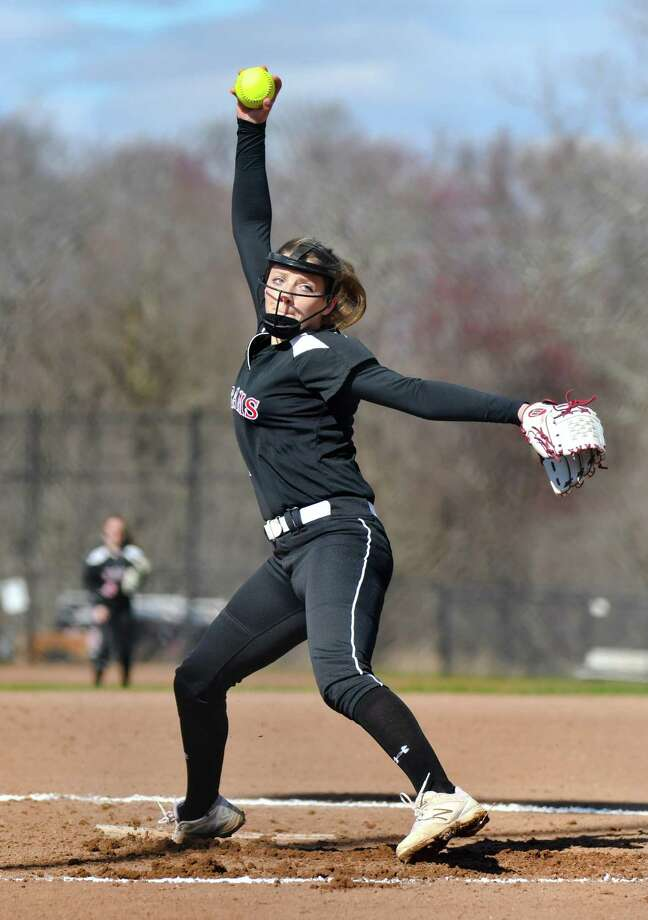 Starting pitcher Gillian Kane (5) of the New Canaan Rams delivers a pitch. Photo: Gregory Vasil / For Hearst Connecticut Media / Connecticut Post Freelance
