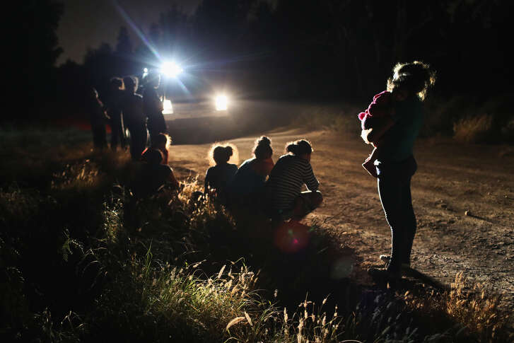 MCALLEN, TX - JUNE 12: U.S. Border Patrol agents arrive to detain a group of Central American asylum seekers near the U.S.-Mexico border on June 12, 2018 in McAllen, Texas. The group of women and children had rafted across the Rio Grande from Mexico and were detained before being sent to a processing center for possible separation. Customs and Border Protection (CBP) is executing the Trump administration's 'zero tolerance' policy towards undocumented immigrants. U.S. Attorney General Jeff Sessions also said that domestic and gang violence in immigrants' country of origin would no longer qualify them for political asylum status. (Photo by John Moore/Getty Images)