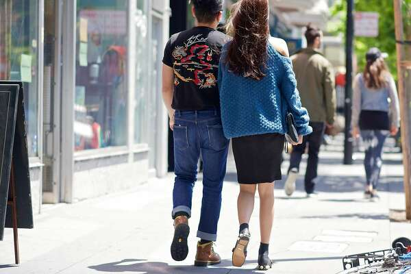 Seen in the Mission District: He wears a Diesel shirt, and she wears Gucci shoes.