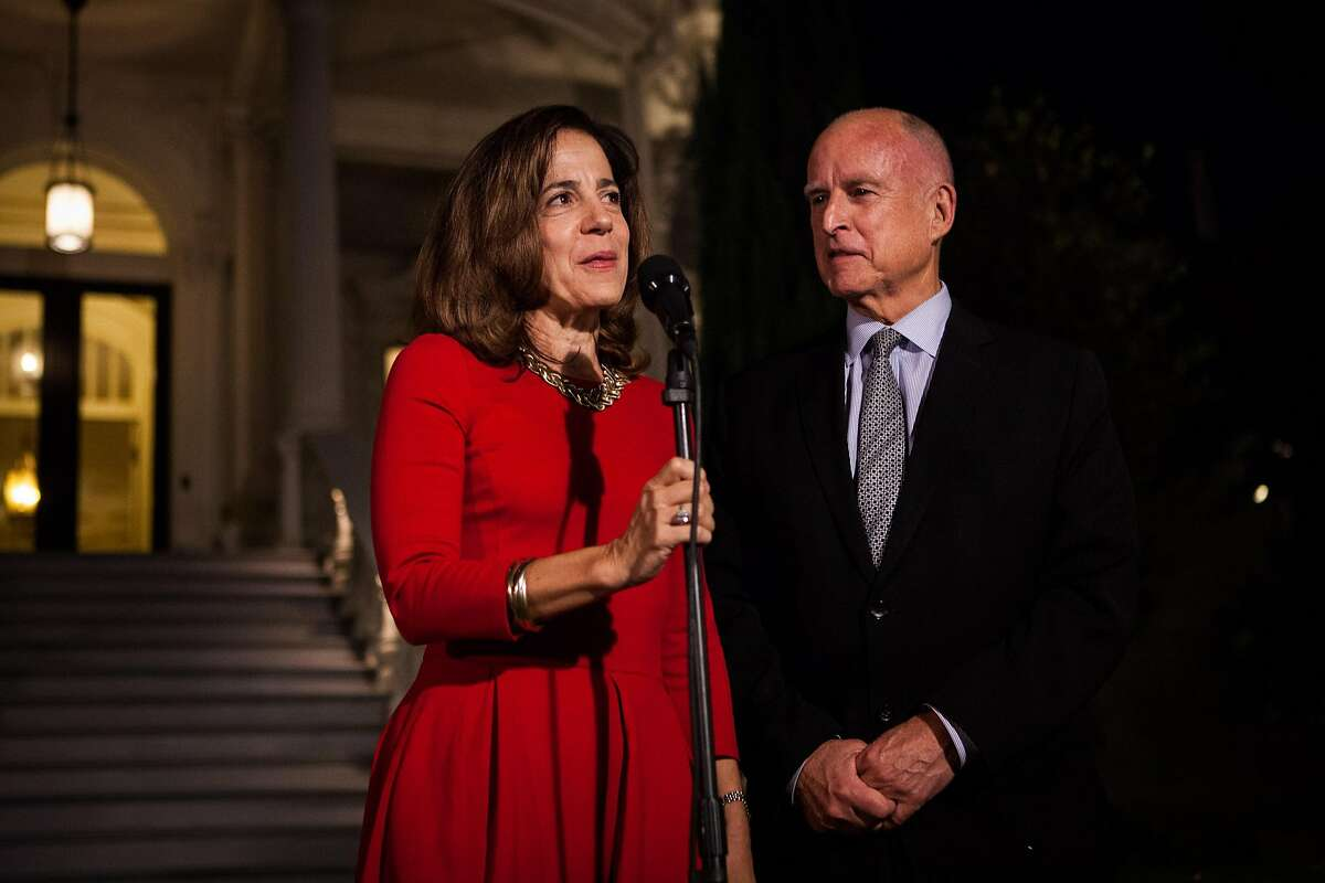 Anne Gust Brown, with Gov. Jerry Brown, speaks to the media after being reelected to a fourth term in front of the Governor's Mansion in Sacramento, California, November 4, 2014.