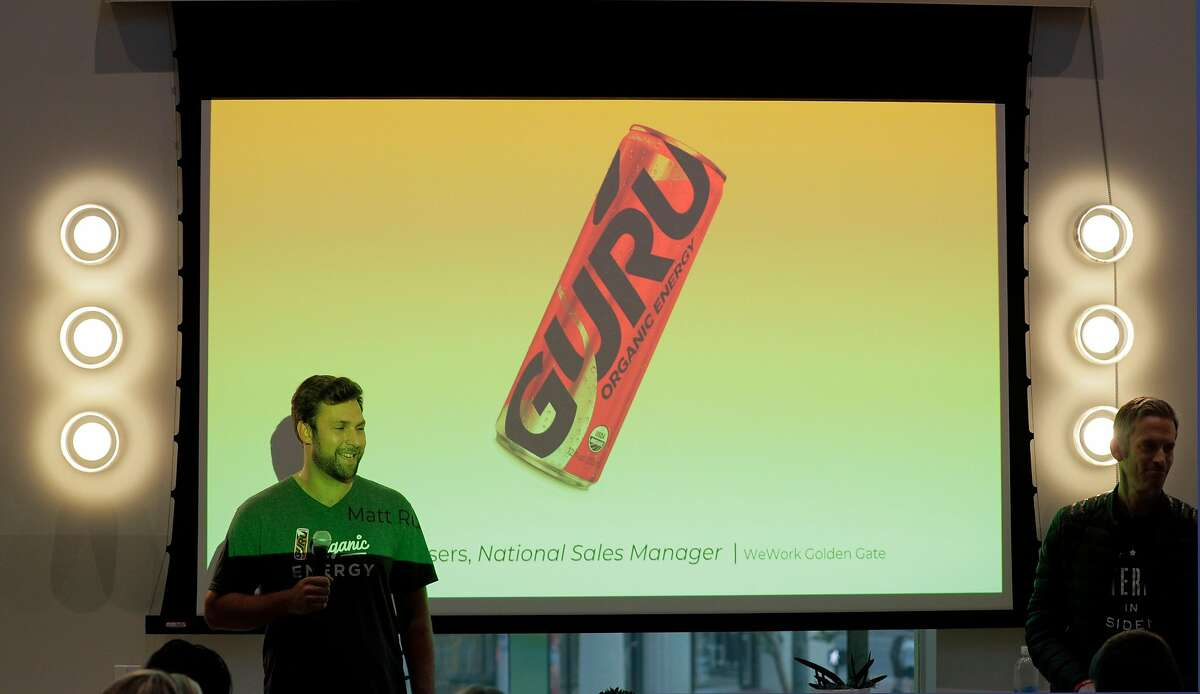 Matt Ruyssers with Guru, an organic energy drink presents his product during pitch night for the new WeMRKT concept at WeWork in San Francisco Calif., on Tuesday, August 7, 2018. The company will partner with businesses, both food and dry goods retailers, to hold pop-up shops inside WeWorks, open to members and their guests.