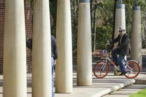 Peter Doyle takes a bike out for a test ride as The Woodlands introduces a new dockless bike sharing program, MoBike, at Town Green Park Friday, Jan. 5, 2018. The bikes don't need to be returned to a specific location at the end of a users ride and can be unlocked by a new user with phone app. Mobike maintains a small staff in The Woodlands to repair bikes, find misplaced units or help in other manners.