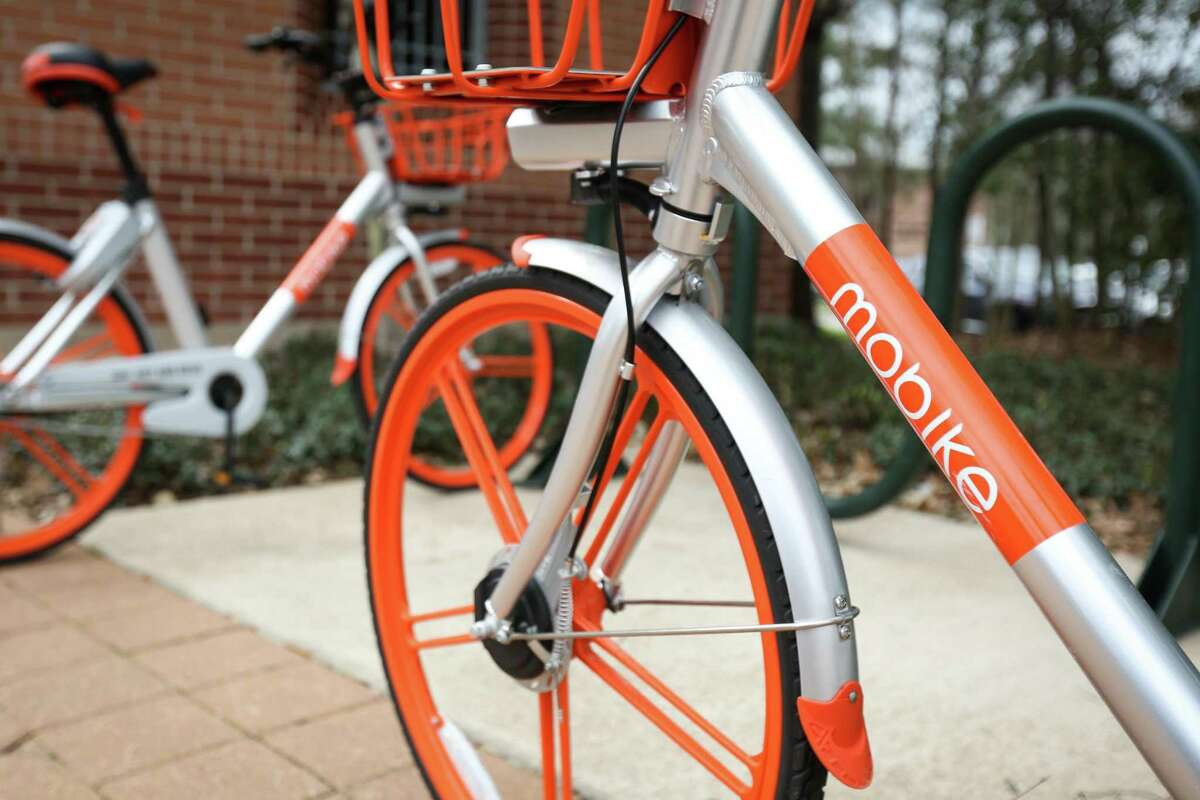 Bicycles from Mobike, a bike sharing company, are pictured on Tuesday, Feb. 20, 2018, at Town Green Park in The Woodlands. The company mysteriously ceased operation in October, removing all the bicycles from The Woodlands and leaving township officials with no answers as to what happened.