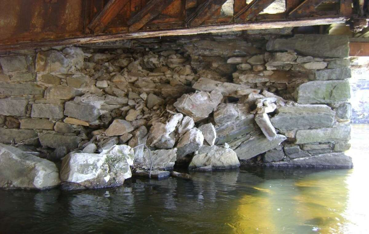 The downstream section of the West Main Street bridge is collapsing and the floor beams have corroded.