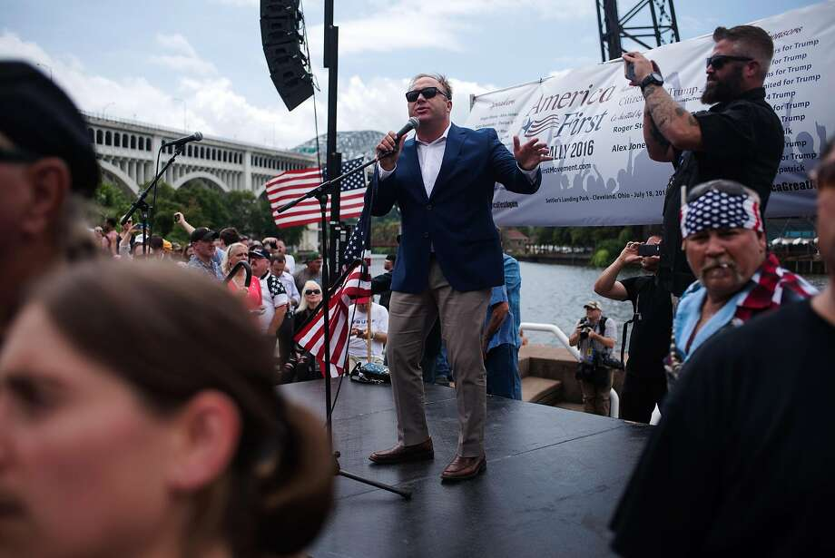 FILE -- Alex Jones speaks at a pro-Trump Rally in Cleveland during the Republican National Convention, July 18, 2016. The conspiracy theorist's forced exit from several online platforms highlights one of Facebook�s international issues that has made its way back to the United States � online unrest potentially becoming real-world violence. (Hilary Swift/The New York Times) Photo: Hilary Swift / New York Times 2016