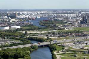 An aerial view of Sims Bayou and 225 La Porte Freeway is shown in the foreground during a Houston Parks Board Bayou Greenways 2020 project tour in October 2017. The Buffalo Bayou as it flows through the Houston Ship Channel is shown in background. ( Melissa Phillip / Houston Chronicle )
