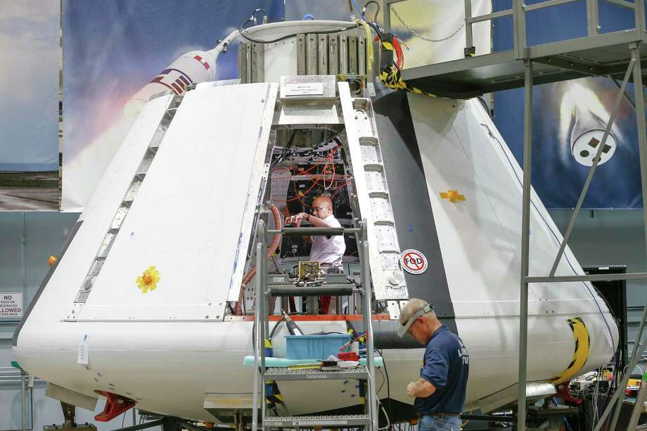 NASA workers prepare the Orion Spacecraft Monday, July 16, 2018, in Houston. Johnson Space Center is powering up the Orion test module to make sure it is functioning well. Photo: Steve Gonzales,  Staff / Houston Chronicle / © 2018 Houston Chronicle