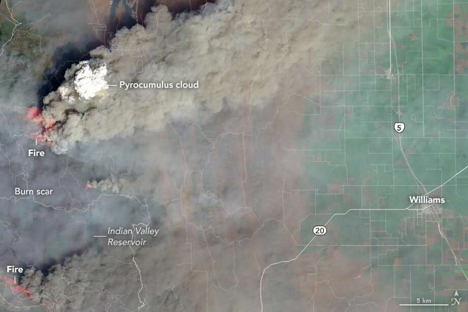 """""""The photograph below, taken on August 2 by an astronaut on the International Space Station, shows another pyrocumulus cloud rising from the Ferguson fire near Yosemite National Park. The park service closed Yosemite Valley and other parts of the park due to heavy smoke,"""" NASA reports. Photo: NASA"""
