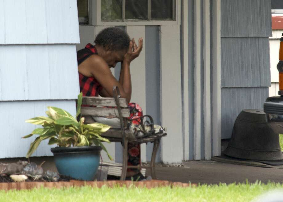 A woman who shot a masturbating bicyclist who was trying to break into her southeast Houston home will not be charged after an investigation. Here, the woman is pictured moments after the shooting Tuesday, Aug. 7, 2018. Photo: Jay R. Jordan