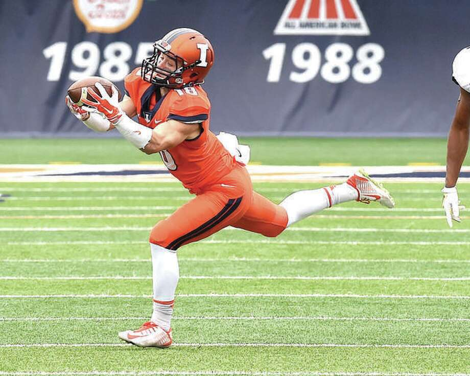 University of Illinois wide receiver Mike Dudek makes a catch during his freshman season in 2014. Dudek is back after two ACL surgeries and is preparing for the season. Photo:       Cary Frye | For The Telegraph
