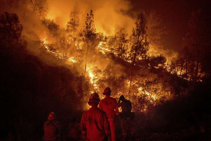 Firefighters monitor a backfire while battling the Ranch Fire, part of the Mendocino Complex Fire, on Tuesday, Aug. 7, 2018, near Ladoga, Calif. (AP Photo/Noah Berger)