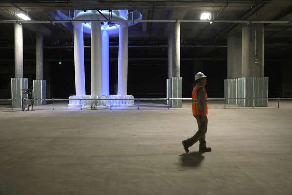 Designer engineer Skip Sowko shows the train box, a cavernous basement of the new Salesforce Transit Center, where trains will one day pull in seen on Wednesday, Aug. 8, 2018 in San Francisco, Calif.
