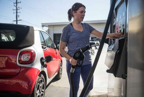 The low carbon fuel standard adds 12 to 14 cents per gallon to the cost of gasoline in California, according to an estimate from the Oil Price Information Service. Photo: Jessica Christian / The Chronicle