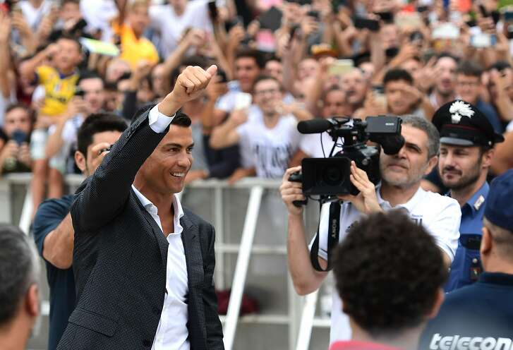 Portuguese attacker Cristiano Ronaldo gestures as he arrives on July 16, at the Juventus medical center at the Alliance stadium in Turin.  Cristiano Ronaldo arrived in Turin ahead of his official unveiling as Juventus' superstar summer signing on July 17. / AFP PHOTO / Miguel MEDINAMIGUEL MEDINA/AFP/Getty Images
