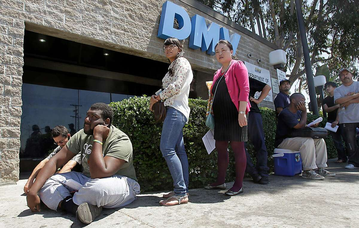 The line outside the DMV office in South Los Angeles is long on Tuesday, Aug. 14, 2012. A California DMV data operator slept three hours a day at her desk for three years, and the department failed to take disciplinary action, despite complaints from her colleagues, according to an audit. (Luis Sinco/Los Angeles Times/TNS)