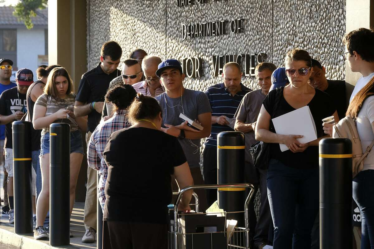 People line up at the California Department of Motor Vehicles prior to opening in the Van Nuys section of Los Angeles on Tuesday, Aug. 7, 2018. California lawmakers are seeking answers from the Department of Motor Vehicles about hours-long wait times that have prompted public outcry. (AP Photo/Richard Vogel)