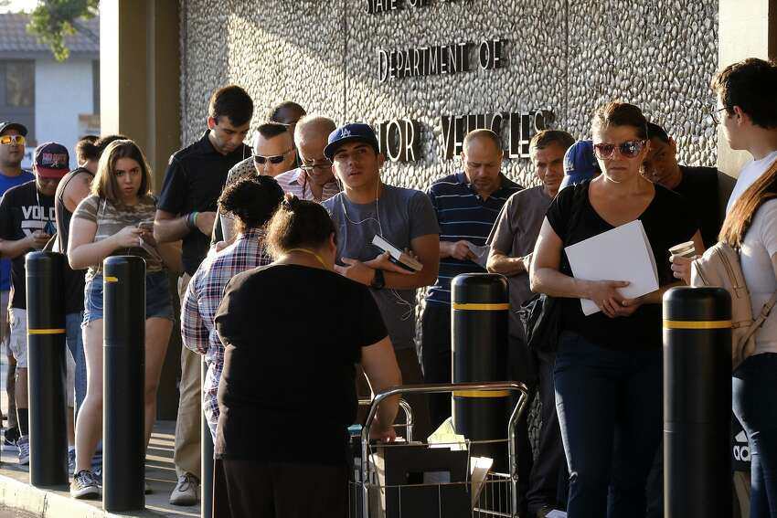 People line up at the California Department of Motor Vehicles prior to opening in the Van Nuys section of Los Angeles on Tuesday, Aug. 7, 2018. An audit by the state caught various abuses by California workers, including a napping CSU officer. The Department of Motor Vehicles have gone through various audits as well, as residents seek Real IDs and resulting lines have spiraled out of control.