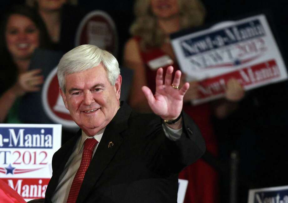 Republican presidential candidate former House Speaker Newt Gingrich waves to supporters before speaking to a crowd gathered for a rally after he won the Georgia primary March 6, 2012, in Atlanta. Through the years, Gingrich hasn't been able to make up his mind about Latinos. Photo: John Bazemore /AP / AP