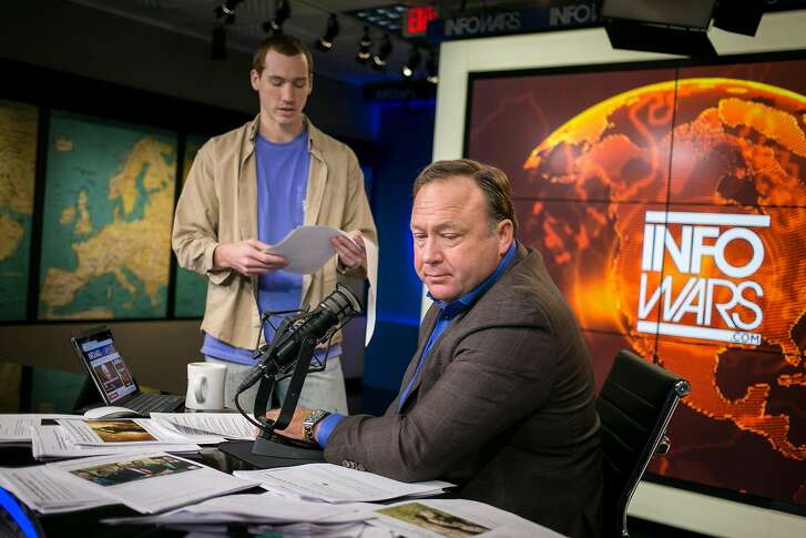 FILE -- Alex Jones, the right-wing conspiracy theorist, before his show in Austin, Feb. 17, 2017. Over the past several days Apple, Facebook, YouTube and Spotify have removed most of Alex Jones� programming from their services.Credit (Ilana Panich-Linsman/The New York Times)