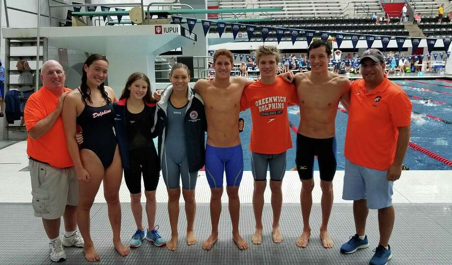 The Greenwich YWCA Dolphins swim team made their mark at the National Club Swimming Association Championships in Indianapolis, Ind., recently. Pictured from left to right: coach Nick Cavataro, Samantha Scott, Meghan Lynch, Kate Hazlett,  Tommy Lewis,  Alexander Hazlett,  Parker Scott and coach Jeremy Cochran Photo: Contributed Photo / Contributed Photo / Stamford Advocate Contributed