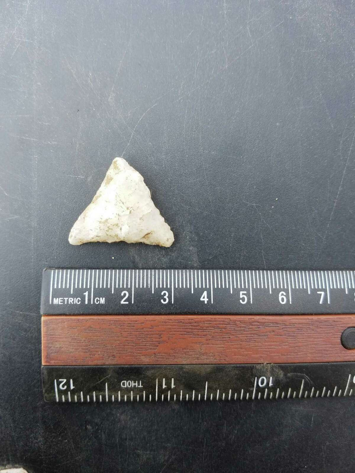 A quartz-point arrowhead unearthed at the Walk Bridge construction zone in East Norwalk.