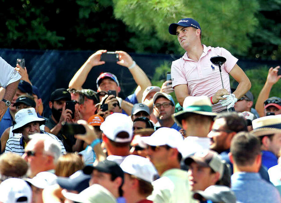 Justin Thomas watches his tee shot on the 15th hole during a Wednesday practice round for the PGA Championship at Bellerive Country Club. Photo:       AP